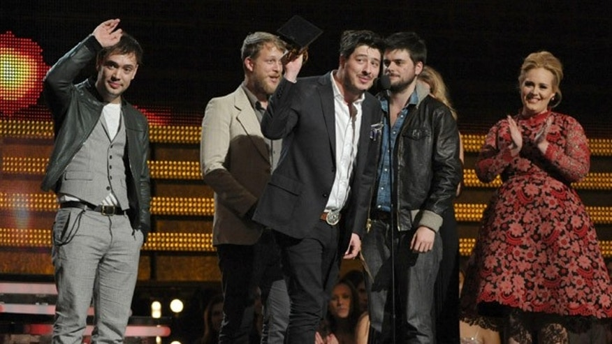 "Feb. 10, 2013: Mumford & Sons, from left, Ben Lovett, Ted Dwayne, Marcus Mumford and Country Winston Marshall accept the award for album of the year for ""Babel"" at the 55th annual Grammy Awards."