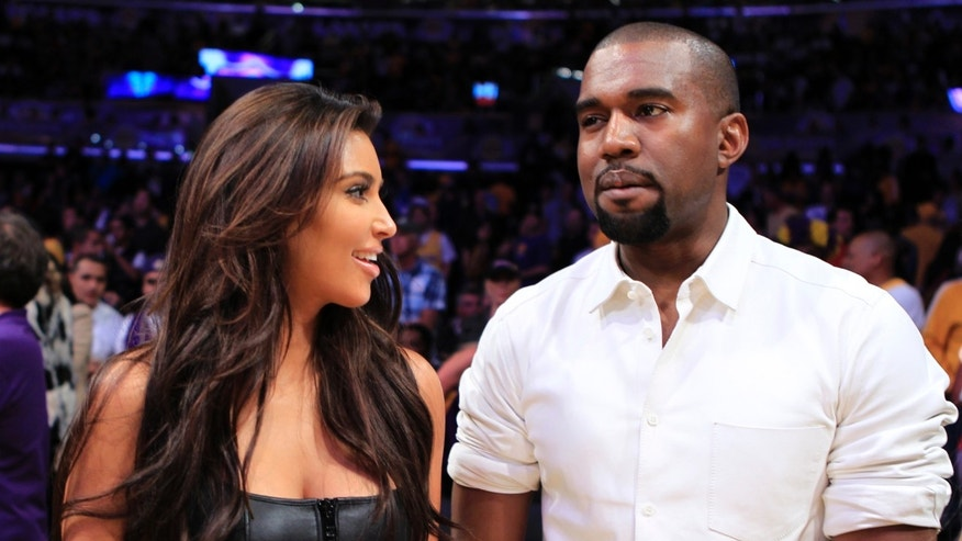 Kim Kardashian and musician Kanye West watch the Los Angeles Lakers play the Denver Nuggets in Los Angeles, California May 12, 2012.