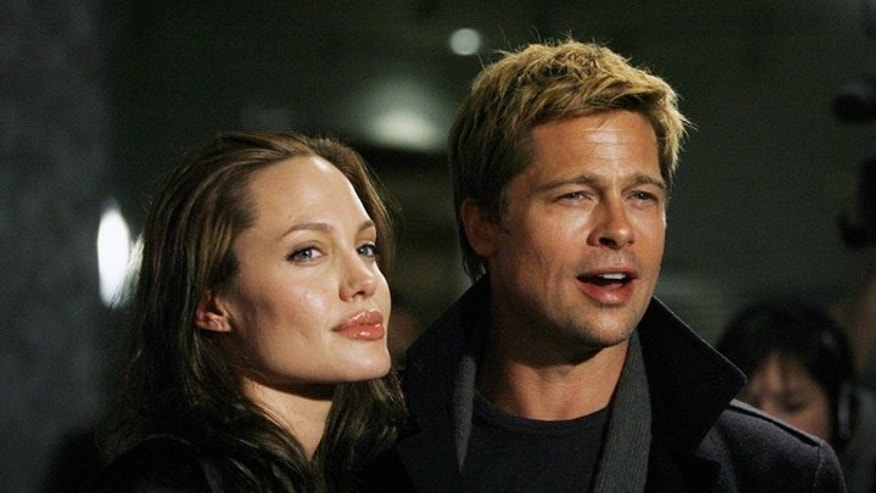 "Executive producer Brad Pitt and actress Angelina Jolie attend the premiere of 'God Grew Tired of Us' at the Pacific Design Center in Los Angeles in this January 8, 2007 file photograph. Jolie and Pitt are engaged to marry, a spokeswoman for Pitt said on April 13, 2012. ""Yes, it's confirmed. It is a promise for the future and their kids are very happy. There's no date set at this time,"" Pitt's spokeswoman Cynthia Pett-Dante told Reuters. Jolie was photographed this week wearing a large diamond ring on her engagement finger. Pitt and Jolie have been a couple since 2005, and are raising six children together, but they have never married. REUTERS/Mario Anzuoni/Files (UNITED STATES - Tags: ENTERTAINMENT SOCIETY)"