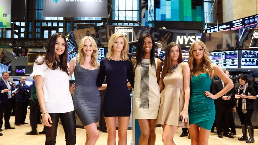 Sports Illustrated Swimsuit models (left to right) Jessica Gomes, Anne Vyalitsyna, Kate Boch, Adora Akubilo, Natasha Barnard and Jessica Perez pose on the floor of the New York Stock Exchange, February 11, 2013.