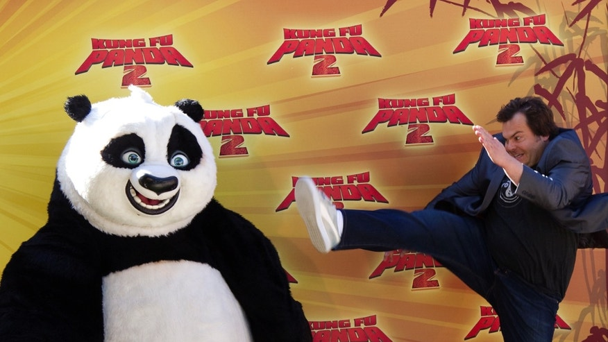 "Jack Black poses with ""Kung Fu Panda"""