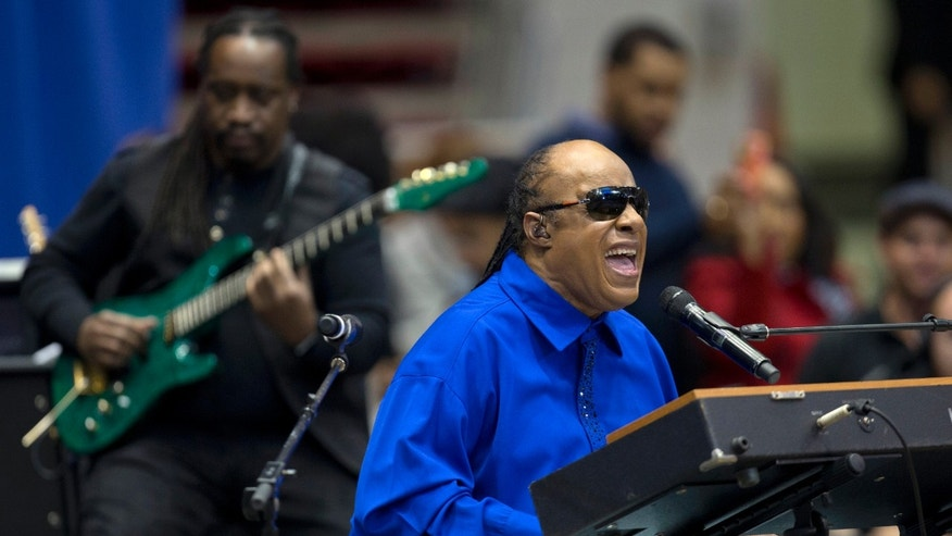 FILE - In this Nov. 4, 2012 file photo, Stevie Wonder performs at a campaign event for President Barack Obama at the Fifth Third Arena on the University of Cincinnati campus in Cincinnati.  Wonder is not excited about the use of Lil Wayne's vulgar lyrics that reference Emmett Till, a black teen who was killed in 1955 for allegedly whistling at a white woman. The R&B legend says the rapper's disturbing verse should not have made it beyond the recording studio for the world to hear.(AP Photo/Carolyn Kaster)