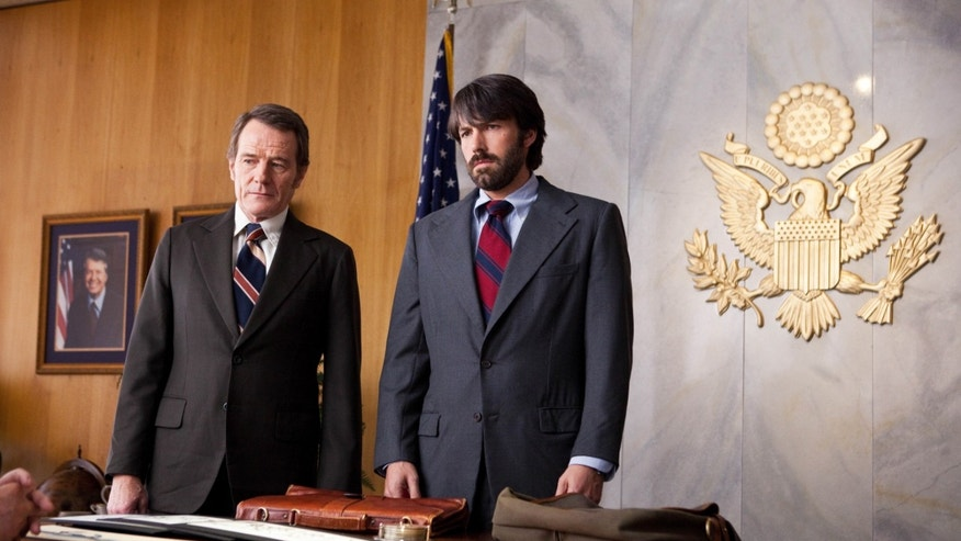 "FILE - Photo released by Warner Bros. Pictures shows Bryan Cranston, left, as Jack O'Donnell and Ben Affleck as Tony Mendez in ""Argo."""