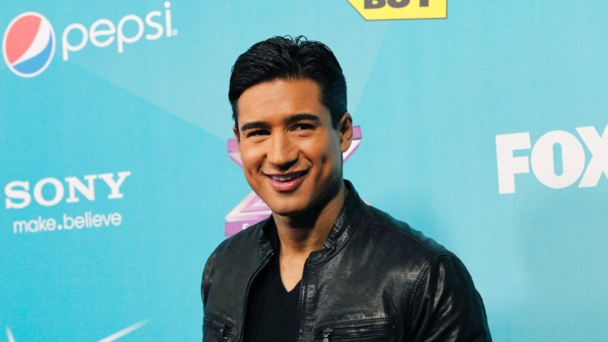 "Host Mario Lopez poses at the party for the finalists of television series ""The X Factor"" in Los Angeles, California November 5, 2012"