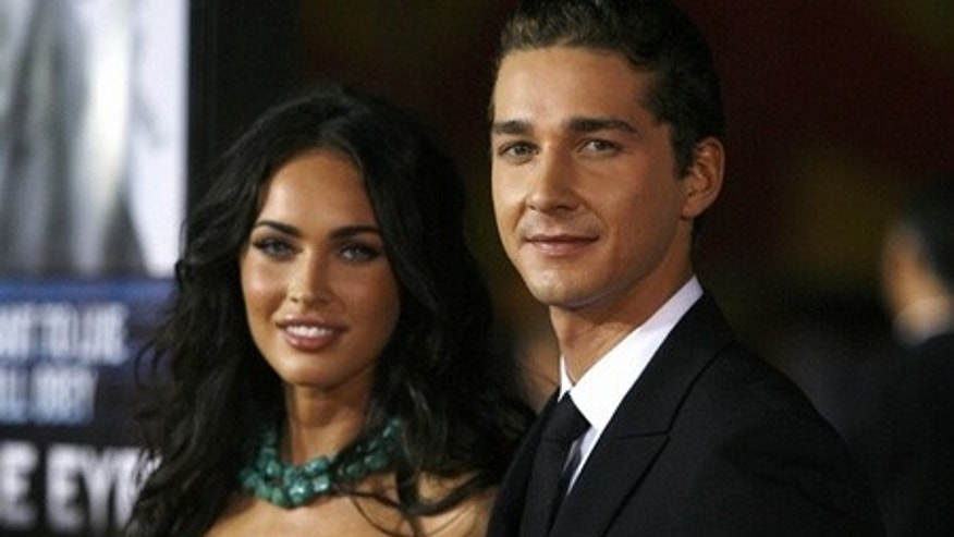 "Cast member Shia LaBeouf (R) poses with actress Megan Fox at the premiere of the movie ""Eagle Eye"" at the Grauman's Chinese theatre in Hollywood, California September 16, 2008.  The movie opens in the U.S. on September 26.  REUTERS/Mario Anzuoni   (UNITED STATES)"