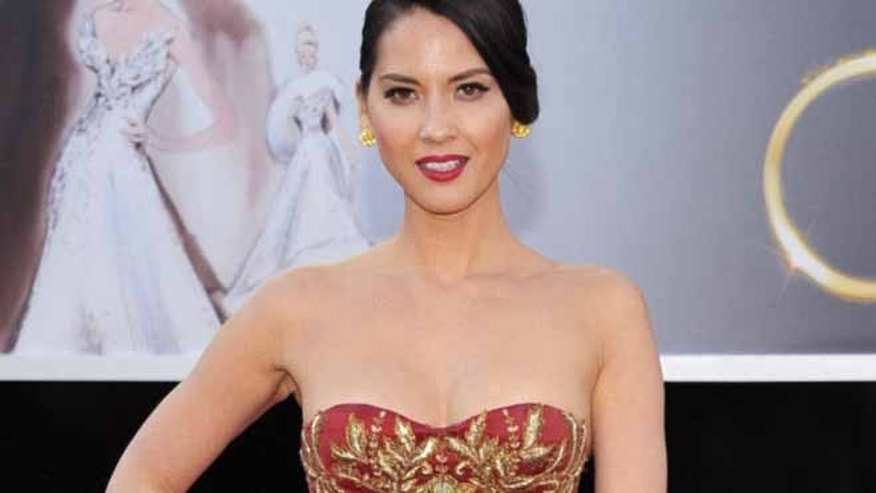 Actress Olivia Munn arrives at the Oscars at the Dolby Theatre on Sunday Feb. 24, 2013, in Los Angeles. (Photo by John Shearer/Invision/AP)