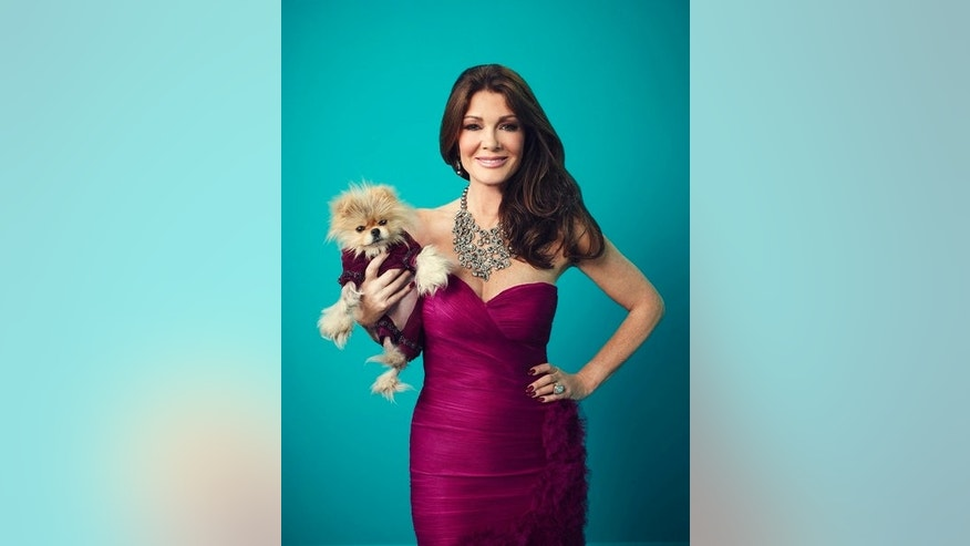 Lisa Vanderpump poses with her dog, Giggy.