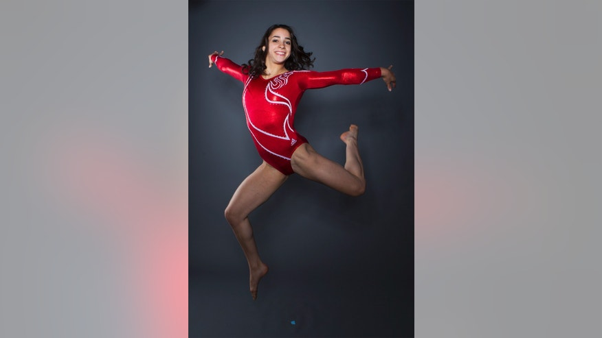 Gymnast Aly Raisman poses for a portrait.