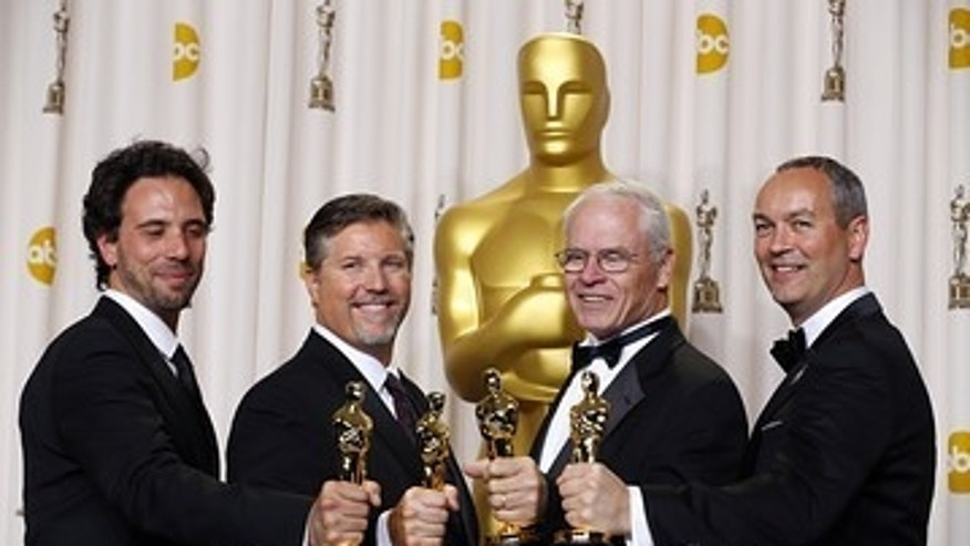 "From left, Guillaume Rocheron, Bill Westenhofer, Erik-Jan De Boer and Donald R. Elliott with their Oscar for visual effects for ""Life of Pi."""