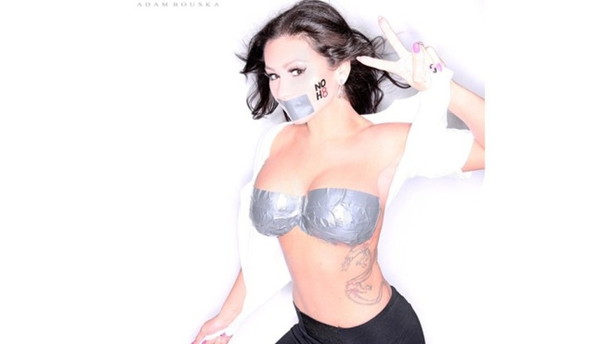JWOWW poses for a NOH8 photo shoot.