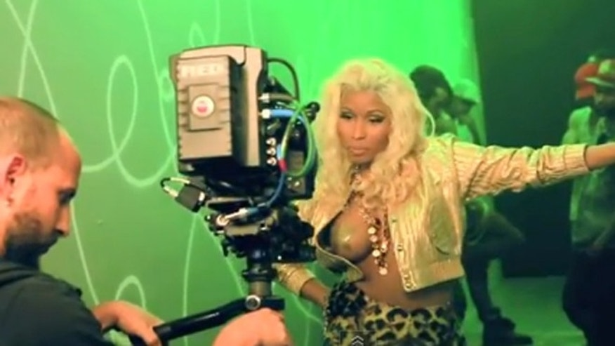 Nicki Minaj is show in a scene from her latest music video.