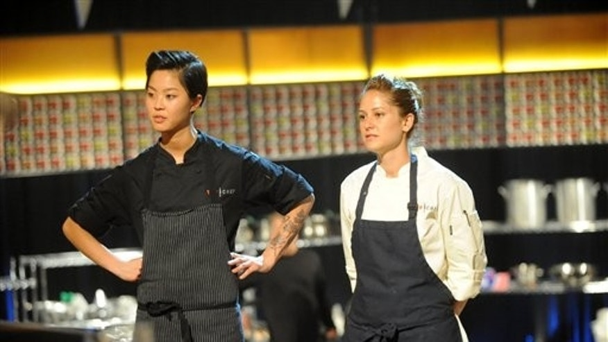 "This image released by Bravo shows chef contestants Kristen Kish, left, and Brooke Williamson in a scene from ""Top Chef: Seattle."""