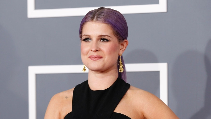 Television personality Kelly Osbourne arrives at the 55th annual Grammy Awards in Los Angeles, California February 10, 2013.