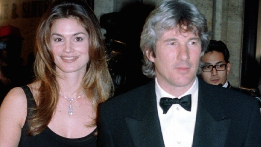Supermodel Cindy Crawford and her husband actor Richard Gere arrive at the 13th annual Council of Fashion Designers Association awards in New York Feb. 7, 1994.