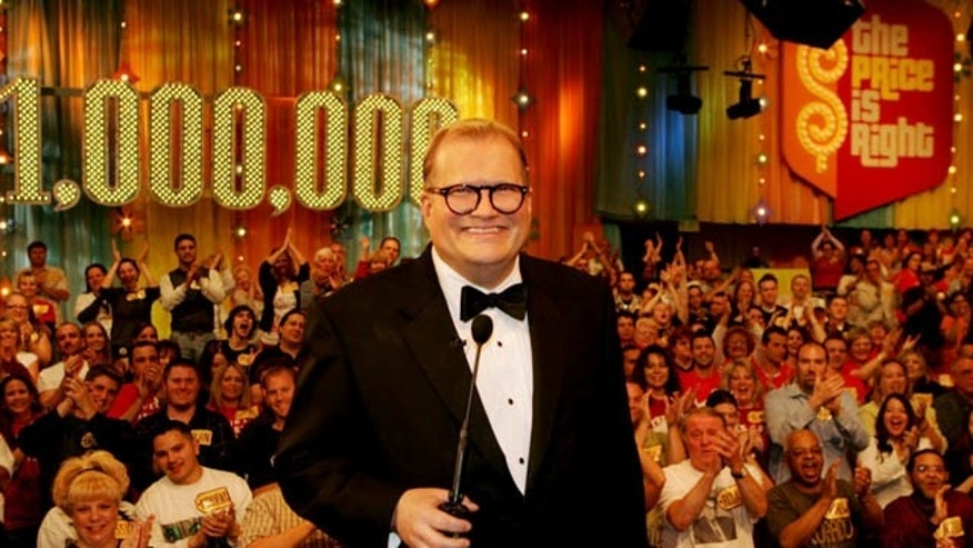 "In this February 2008 publicity image released by CBS Entertainment, host Drew Carey hosts pauses during a taping of of ""The Price is Right Million Dollar Spectacular."""