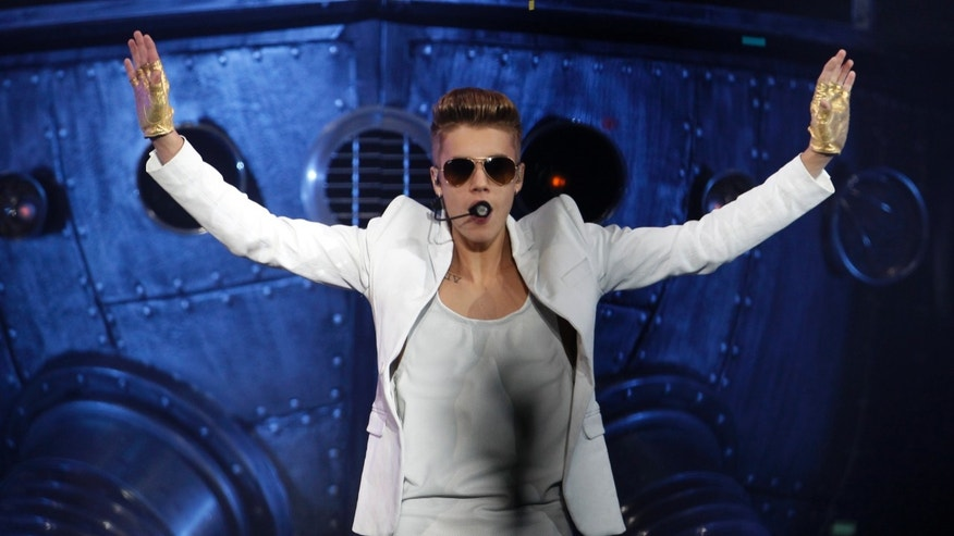 Canadian singer Justin Bieber performs in a concert at the Atlantico pavilion in Lisbon March 11, 2013.