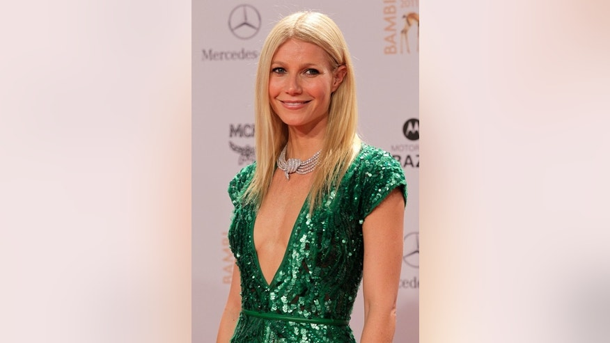 Actress Gwyneth Paltrow poses on the red carpet as she arrives for the 63rd Bambi media award ceremony in Wiesbaden November 10, 2011. Every year, the German media company 'Hubert Burda Media', honors celebrities from the world of entertainment, literature, sports and politics with the Bambi awards. REUTERS/Wolfgang Rattay (GERMANY  - Tags: ENTERTAINMENT)   - RTR2TU8C