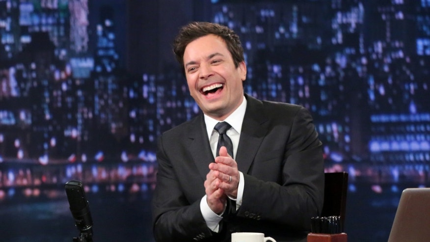"This Feb. 21, 2013 photo released by NBC shows Jimmy Fallon, host of ""Late Night with Jimmy Fallon,"" on the set in New York."