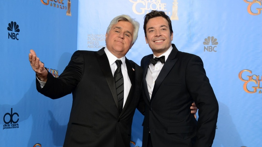 "This Jan. 13, 2013 file photo shows Jay Leno, host of ""The Tonight Show with Jay Leno,"" left, and Jimmy Fallon, host of ""Late Night with Jimmy Fallon"" backstage at the 70th Annual Golden Globe Awards in Beverly Hills, Calif."