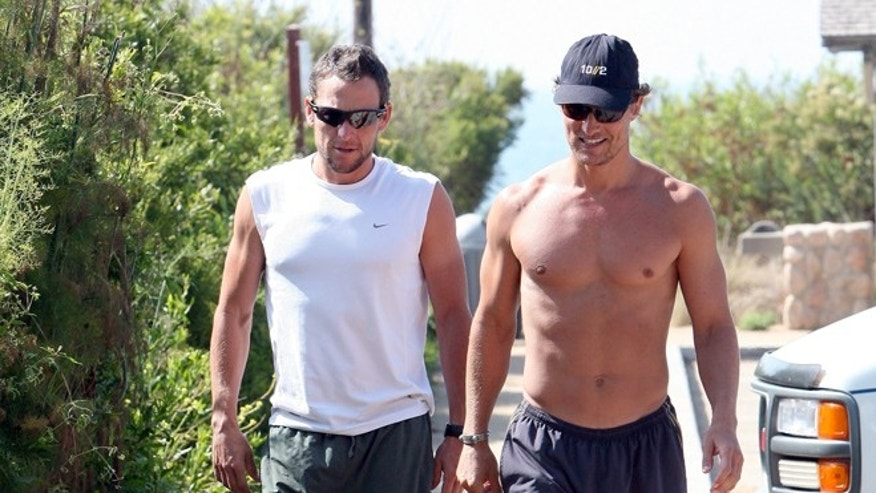 Matthew McConaughey and Lance Armstrong jogging in Malibu July 2, 2008.