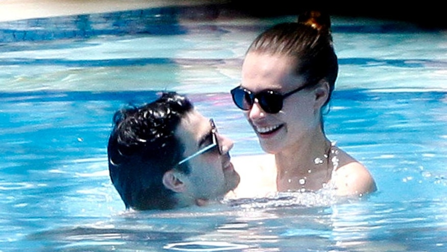 Joe Jonas and Blanda Eggenschwiler relax in the pool in Rio de Janeiro.