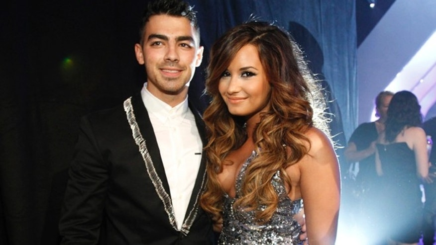 Joe Jonas, here with and Demi Lovato at the 2011 MTV Video Music Awards, denied he and his model girlfriend Blanda Eggenschwiler were in a sex tape.