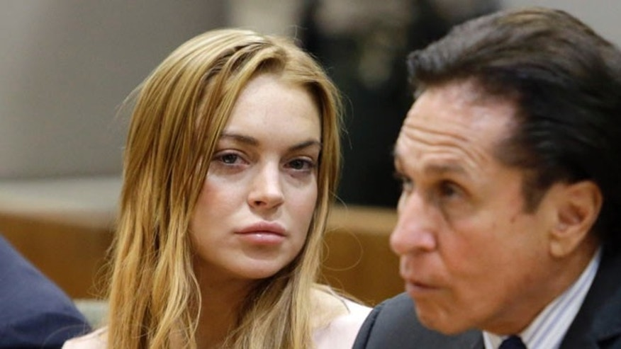 March 18, 2013: Actress Lindsay Lohan, left, and her attorney Mark Heller appear at a hearing in Los Angeles Superior Court.