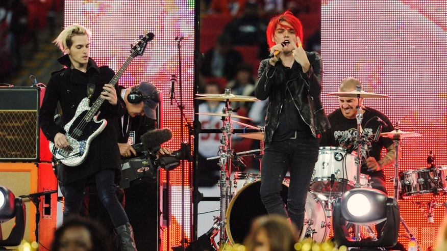 In this Oct. 31, 2010 file photo, My Chemical Romance performs during the pre-game show for the NFL Football game between the Denver Broncos and San Francisco 49ers at Wembley Stadium in London.