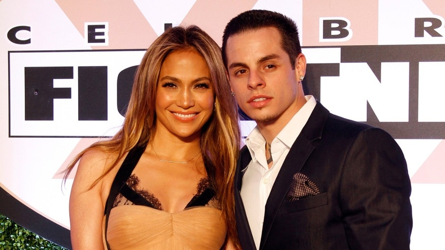 Singer Jennifer Lopez and boyfriend Casper Smart attend Muhammad Ali's Celebrity Fight Night XIX at JW Marriott Desert Ridge Resort & Spa on March 23, 2013 in Phoenix, Arizona.