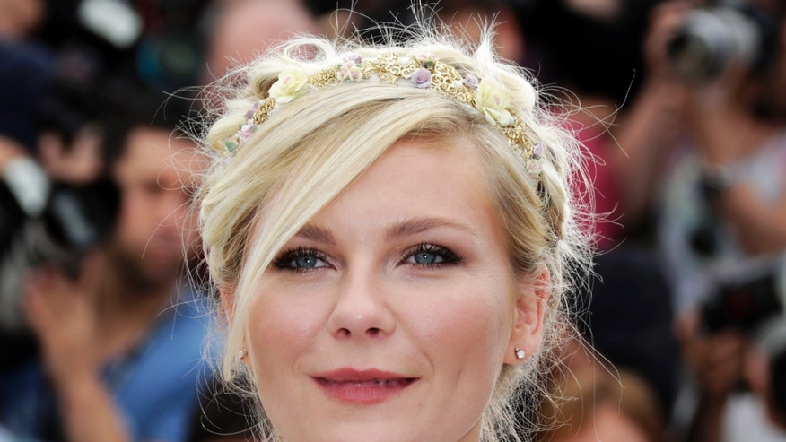 "Cast member Kirsten Dunst poses during a photocall for the film ""On The Road"", in competition at the 65th Cannes Film Festival, May 23, 2012."