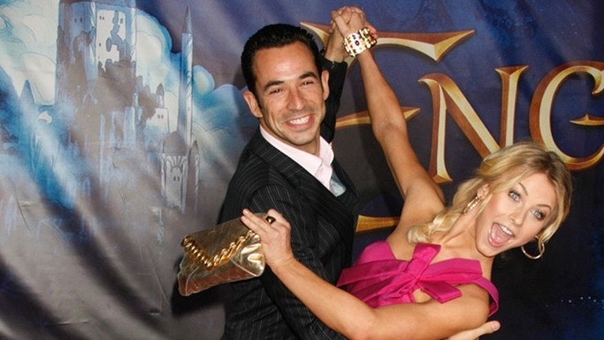 """Dancing with the Stars"" television reality show contestants Brazilian race car driver Helio Castroneves (L) and professional dancer Julianne Hough strike a dance pose as they arrive for the premiere of the film ""Enchanted"" in Hollywood, California November 17, 2007."
