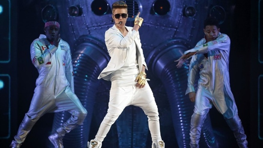 "March 28, 2013: In this file photo, Canadian singer Justin Bieber performs on stage during the ""I Believe Tour "" in Munich, southern Germany."