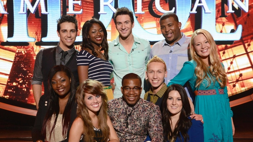 "This March 7, 2013 photo released by Fox shows the 10 finalists, clockwise from top left, Lazaro Arbos, Amber Holcomb, Paul Jolley, Curtis Finch, Jr., Janelle Arthur, Kree Harrison, Devin Velez, Burnell Taylor, Angie Miller and Candice Glover posing on the set of the singing competition series ""American Idol.""   (AP Photo/Fox, Michael Becker)"