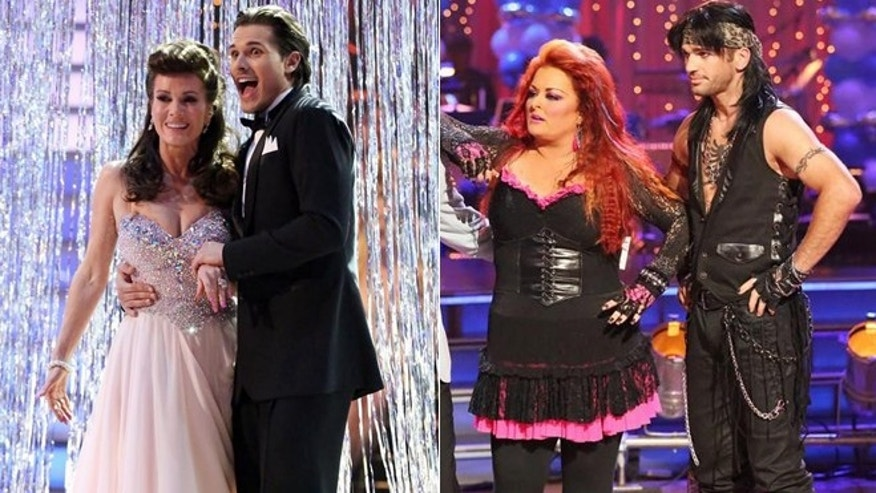 Lisa Vanderpump, left, and Wynonna Judd, right, stand with the dance partners.