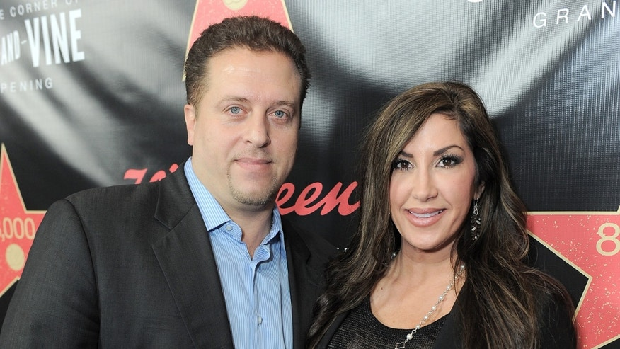 "This Nov. 30, 2012 file photo originally released by Walgreens shows Chris Laurita, left, and his wife Jacqueline Laurita, of ""The Real Housewives of New Jersey,"" at Walgreens 8000th Store Opening in Los Angeles."