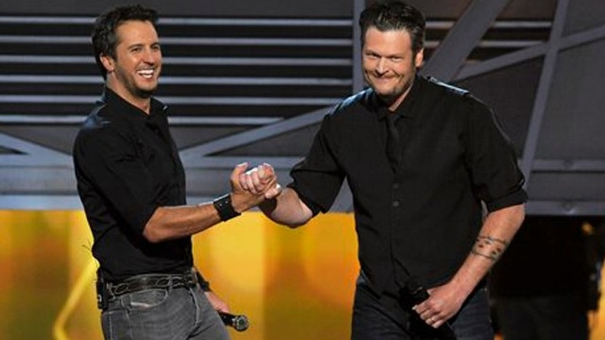 April 7, 2013: Luke Bryan, left, and Blake Shelton speak on stage at the 48th Annual Academy of Country Music Awards at the MGM Grand Garden Arena in Las Vegas.