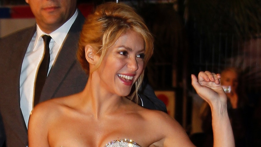 Colombian singer Shakira waves as she arrives at the Cannes festival palace to attend the NRJ Music Awards in Cannes January 28,2012.