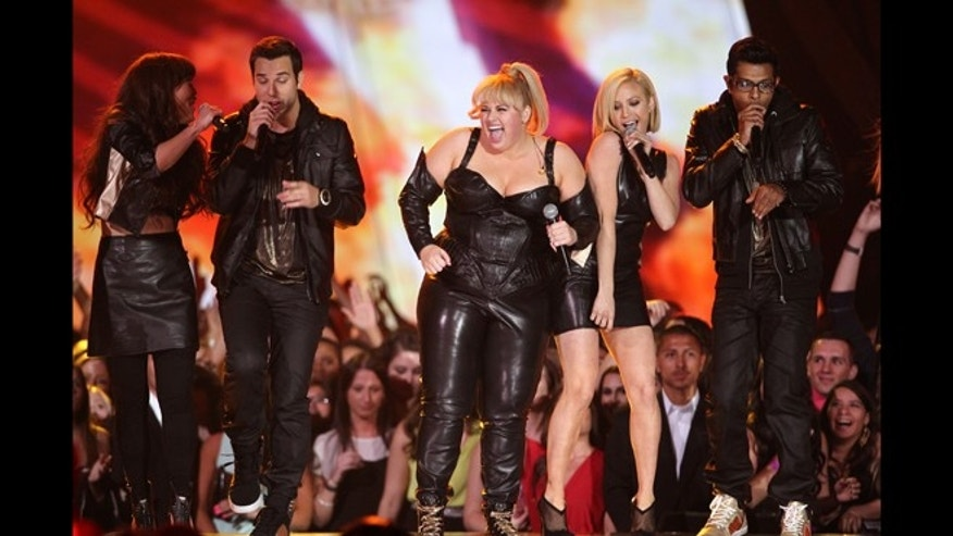 "April 14, 2013: Host Rebel Wilson and the cast of ""Pitch Perfect"" perform onstage at the MTV Movie Awards in Sony Pictures Studio Lot in Culver City, Calif. (Photo by Matt Sayles/Invision /AP)"