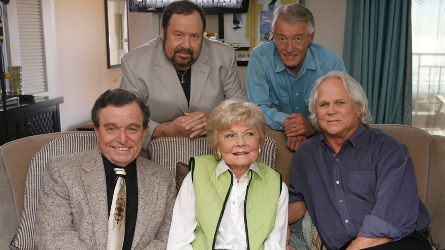 "In this Sept. 27, 2007 file photo, seated, from left, Jerry Mathers, Barbara Billingsley and Tony Dow, and, standing from left, Frank Bank and Ken Osmond, pose for a photo as they are reunited to celebrate the 50th anniversary of the television show, ""Leave it to Beaver,"" in Santa Monica, Calif."