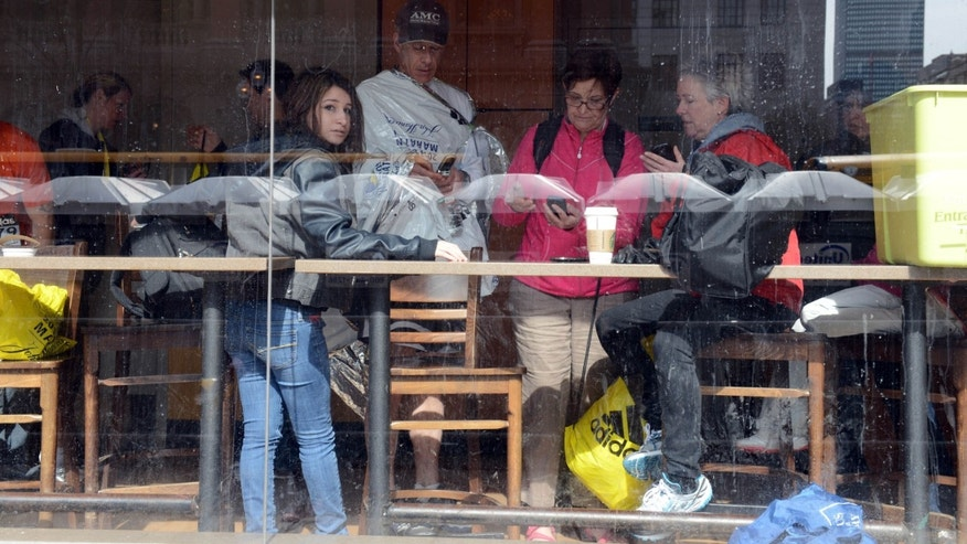 BOSTON, MA - APRIL 15:  People gather in a Starbucks after two bombs exploded during the 117th Boston Marathon on April 15, 2013 in Boston, Massachusetts.