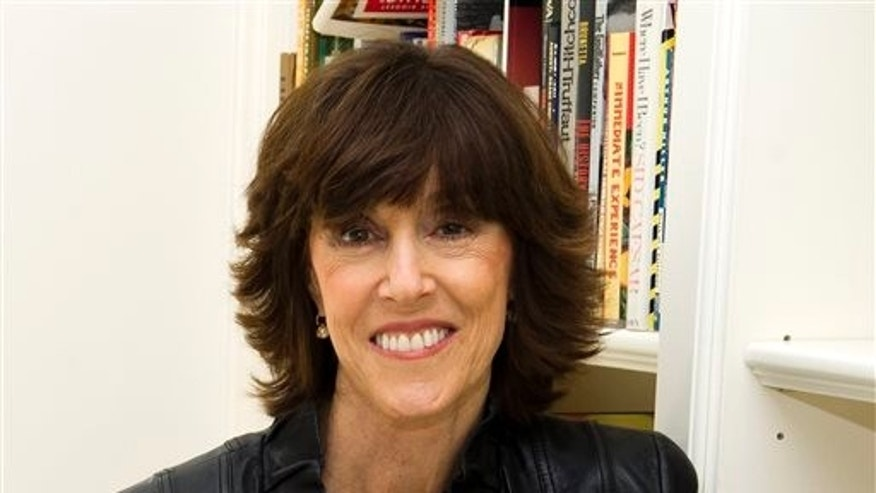 This Nov. 3, 2010 file photo shows author, screenwriter and director Nora Ephron at her home in New York.  The Tribeca Film Festival has created a new award for female filmmakers named after the late Nora Ephron.  Tribeca announced the prize Tuesday, April 16, 2013, on the eve of its 12th annual festival. The award will be presented to a woman writer or director, the festival said, who embodies the spirit and vision of the legendary filmmaker and writer.