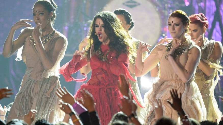 April 14, 2013:  Actress-singer Selena Gomez performs onstage during the 2013 MTV Movie Awards at Sony Pictures Studios in Culver City, Calif.