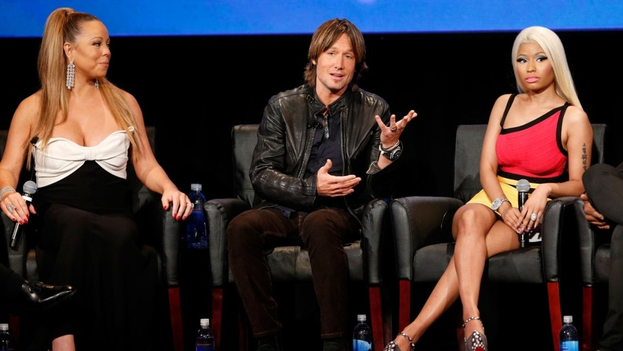 WESTWOOD, CA - JANUARY 09:  (L-R) Singer Mariah Carey, musician Keith Urban, and singer Nicki Minaj onstage during a live Q&A during the season premiere screening of Fox's 'American Idol' at Royce Hall, UCLA on January 9, 2013 in Westwood, California.  (Photo by Imeh Akpanudosen/Getty Images)