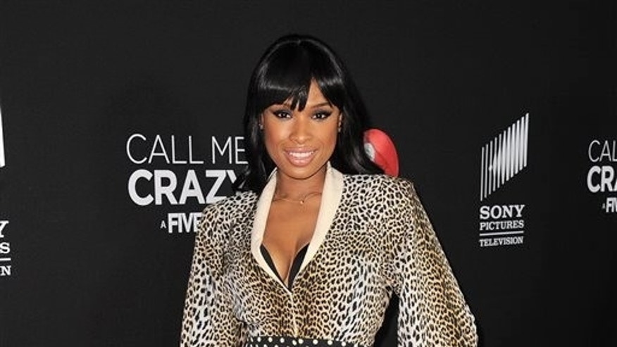 "In this April 16, 2013 file photo, Jennifer Hudson arrives at the world premiere of ""Call Me Crazy: A Five Film"" at the Pacific Design Center, in Los Angeles. Hudson and Christina Aguilera are among the artists set to pay tribute to this year's eclectic group of Rock and Roll Hall of Fame inductees. Aguilera and Hudson are scheduled to perform in honor of late disco queen Donna Summer at the 28th annual induction ceremony on Thursday, April 18, 2013, at the Nokia Theatre in Los Angeles."