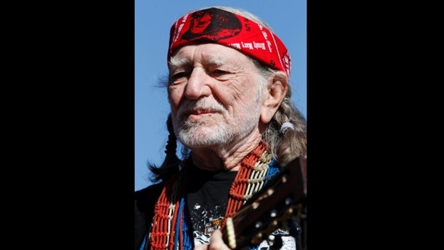 In this Nov. 7, 2010 file photo, Willie Nelson performs before the start of the NASCAR AAA Texas 500 auto race at Texas Motor Speedway, in Fort Worth, Texas. Nelson is sending out his prayers via Twitter Thursday April 18, 2013 after a deadly fertilizer plant explosion rocked West, Texas, a small community north of Waco near where he grew up.