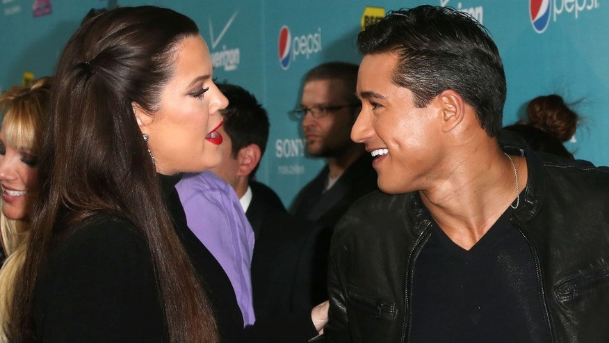 """LOS ANGELES, CA - NOVEMBER 05:  Actress/host Khloe Kardashian Odom (L) and host Mario Lopez attend Fox's """"The X-Factor"""" Finalists Party at The Bazaar at the SLS Hotel Beverly Hills on November 5, 2012 in Los Angeles, California.  (Photo by Frederick M. Brown/Getty Images)"""