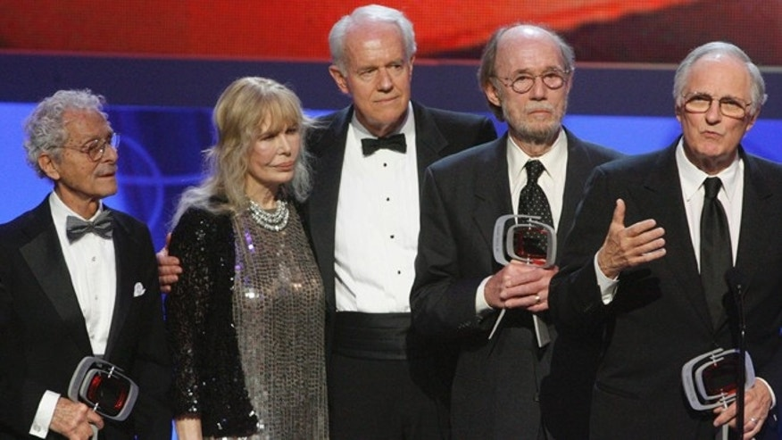 "Cast members of ""M*A*S*H*"" (L-R) Allan Arbus, Loretta Swit, Mike Farrell, Burt Metcalfe and Alan Alda accept the Impact award at the taping of the seventh annual TV Land Awards in Los Angeles, California April 19, 2009."