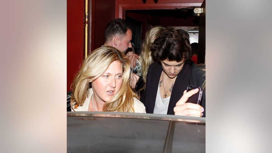 Harry Styles dines with Rod Stewart and his family at Dan Tana's. They were accompanied by Penny Lancaster, Kimberly Stewart and friends as they packed into a Rolls Royce before driving away. April 25, 2013
