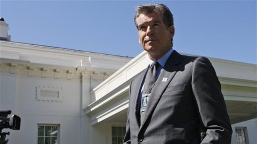 Irish actor Pierce Brosnan, who is also a global ambassador of whale conservation campaigns for the International Fund for Animal Welfare (IFAW), walks from the West Wing of the White House in Washington, Tuesday, May 19, 2009, after attending a meeting. (AP Photo/Charles Dharapak)