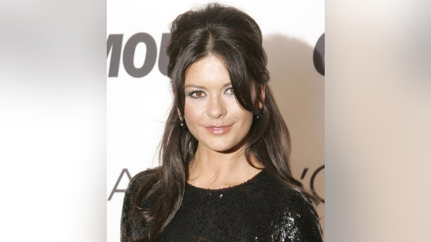Catherine Zeta-Jones poses for pictures on the red carpet at the 2006 Glamour Women of the Year awards New York, Monday, Oct. 30, 2006. Zeta-Jones was among the presenters at the 17th annual awards presentation that honors extraordinary and inspirational women.  (AP Photo/Seth Wenig)